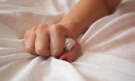 Woman s Hand Squeezing Bed Sheet