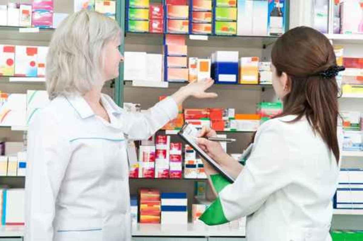 Pharmacy chemist women in drugstore