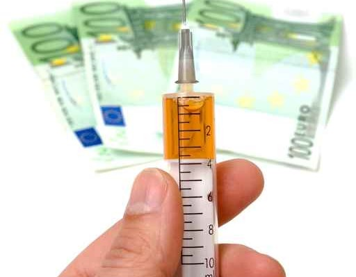 syringe and money