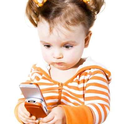 little girl is playing in java game on mobile phone