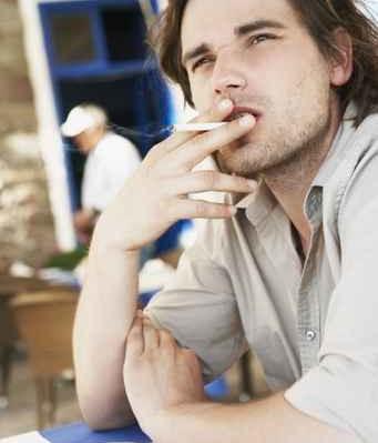 Man smoking cigaret in restaurant