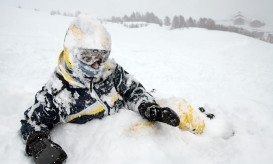 Skier in the snow after falling over