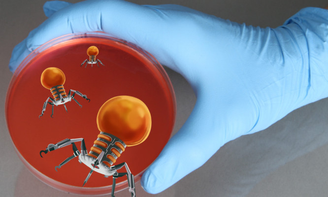 Conceptual illustration of a gloved hand holding a petri dish with nanorobots emerging from the dish. The use of nanotechnology in medicine, particularly as a tool in combating cancer, is an emerging technology.