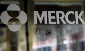 ** FILE ** In this May 22, 2008 file photo, the company logo is seen on the doors of a building at Merck & Co. headquarters in Whitehouse Station, N.J.  Drugmaker Merck & Co. on Tuesday, July 21, 2009, posted a 12 percent drop in second-quarter profit, due to lower sales of its cholesterol drugs and several vaccines, but still beat Wall Street's conservative expectations.(AP Photo/Mel Evans, file)