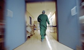 Doctor rushing in hallway