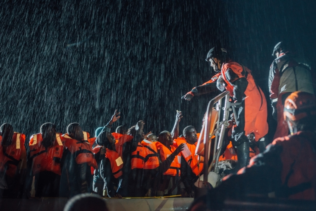 MSF and SOS Mediterannee Search and Rescue personnel operate in appalling conditions in the Mediterranean sea, 22 December 2016, as they help a boat in distress full of refugees and migrants off the northern coast of Libya.