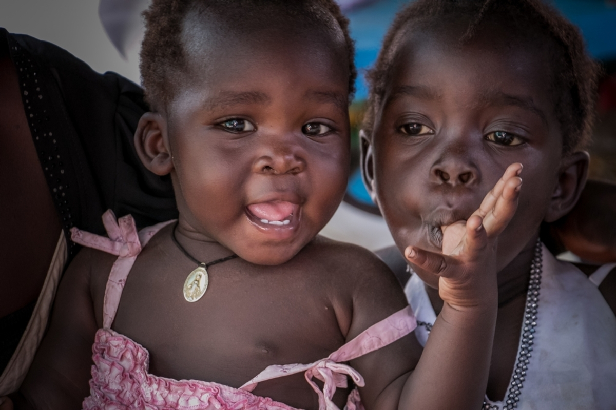 Two young girls attend an MSF clinic in Palorinya refugee camp, Uganda. There is very little healthcare provision in parts of the camp so MSF are setting up clinics to address the healh needs of the growing poulation.