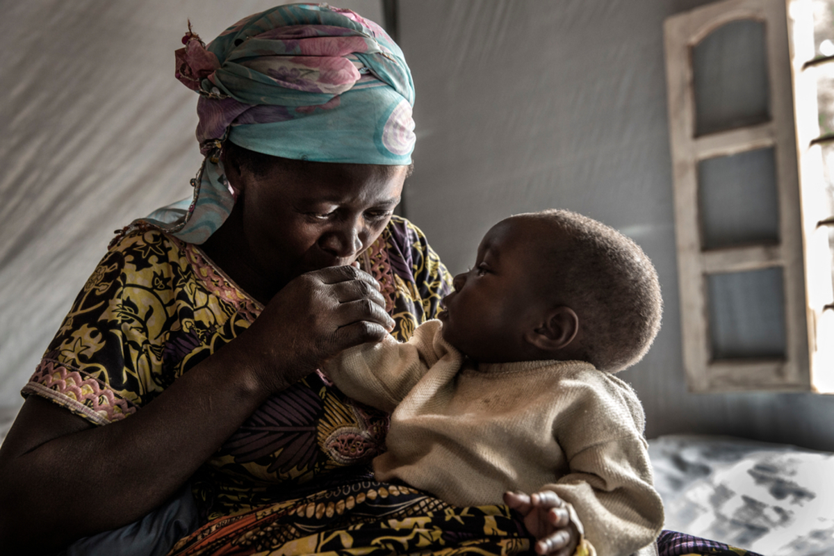 A mother and her child in the Katana CTC. Before MSF set up the centre, cholera treatment cost around US$35. Many patients from rural areas around Katana struggled to pay this and therefore had to wait to receive treatment.