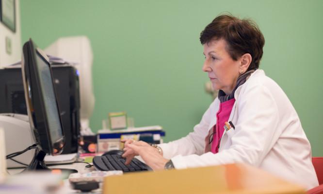 Senior doctor using computer