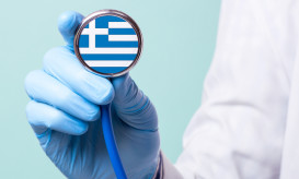 Medicine in Greece is free and paid. Expensive medical insurance. Treatment of disease at the highest level Doctor holding a stethoscope in his hand
