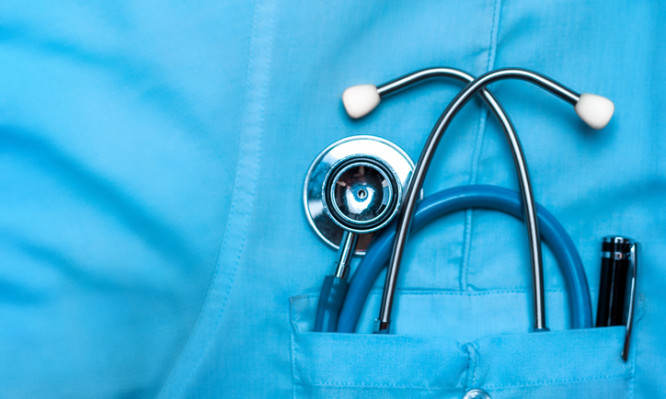 Stethoscope and pen in doctor robe pocket. Concept Of The Global Healthcare, Medicine And Insurance