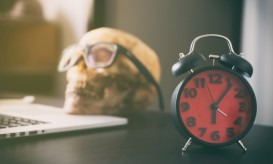 office-work-deadline-with-dead-person-skull-picture-id628977748