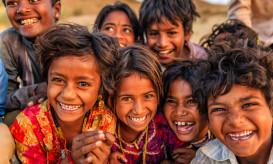 Group of happy Gypsy Indian children - desert village, Thar Desert, Rajasthan, India.