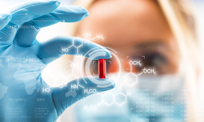 Young attractive female scientist holding a red transparent pill with futuristic scientific air interface with chemical formulas and research data in the foreground