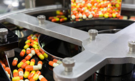 pharmacy medicine capsule pill in production line at medical factory. selective focus.