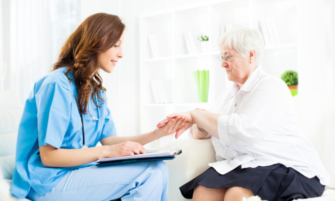 Young female doctor examining psoriasis on hand of an senior woman patient in a doctor's office. Could be used also as Homeopathy Interview. Selective focus to senior woman.